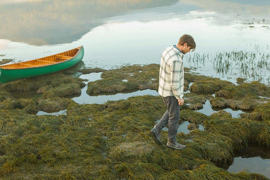 Murray Peltro by a canoe