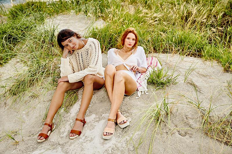 girls sitting dunes