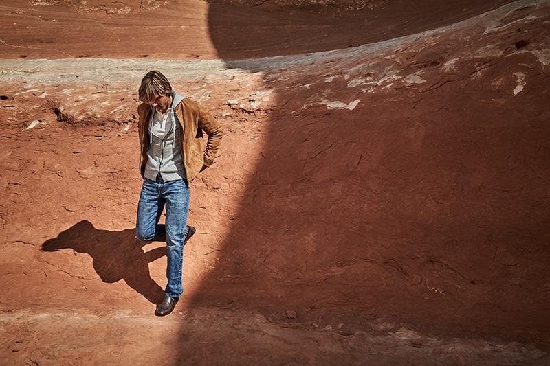 man walking at the shadows edge