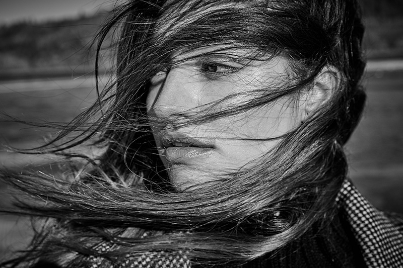 woman with windswept hair black and white