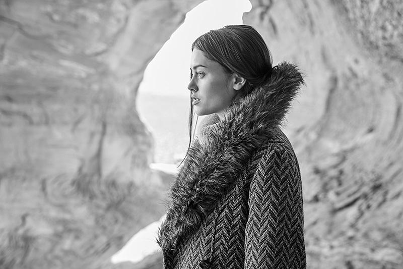 woman wearing fur cuffed coat