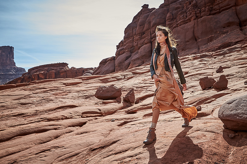 woman midstride in the canyonlands