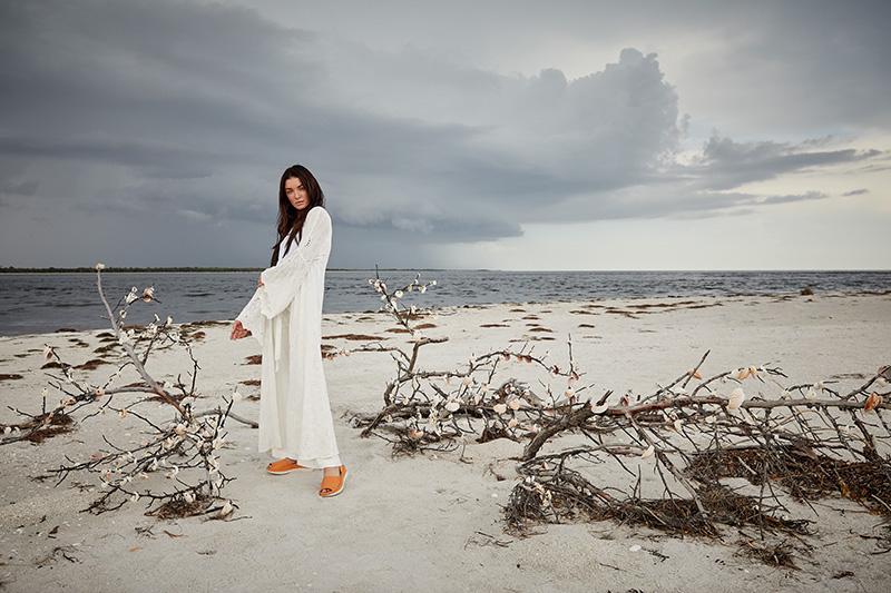woman in white dress, white sand beach