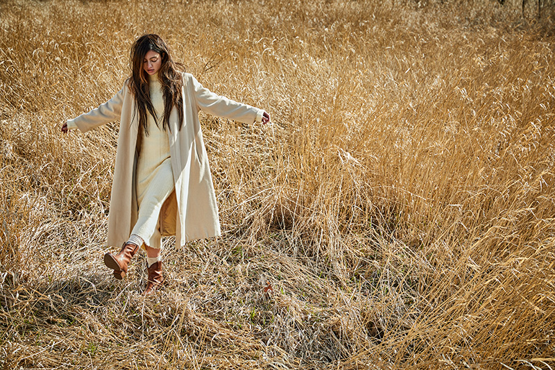 woman kickin' it in the dry grass
